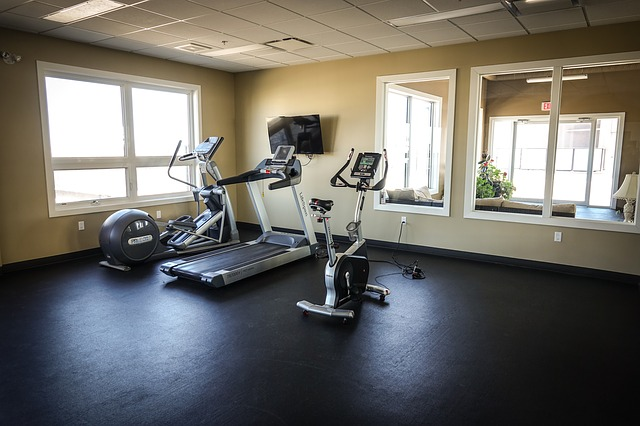 a photo of a gym station with upright stationary bike, treadmill and elliptical machine