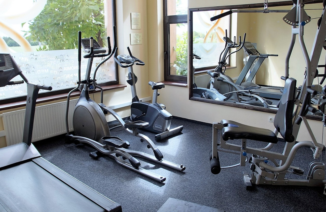 a gym studio equipped with elliptical machine and other home gym equipment