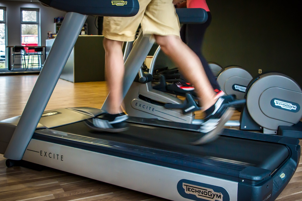 close-up photo of a person running in treadmill