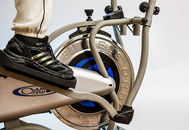 close-up photo focus on indoor cycling shoes and upright stationary bike