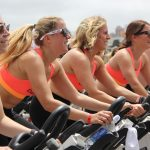 a group of women trying the schwinn ac performance plus indoor cycling