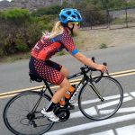 a woman wearing the best women's cycling shorts while pedaling a bicycle