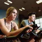 woman and man doing spin class to learn on how to become a spin instructor